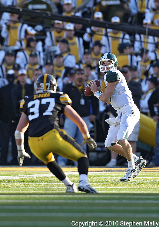 October 30 2010: Michigan State Spartans quarterback Kirk Cousins (8) looks for a receiver during the third quarter of the NCAA football game between the Michigan State Spartans and the Iowa Hawkeyes at Kinnick Stadium in Iowa City, Iowa on Saturday October 30, 2010. Iowa defeated Michigan State 37-6.