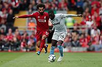 Football - 2018 / 2019 Premier League - Liverpool vs. West Ham United<br /> <br /> Mohamed Salah of Liverpool and Arthur Masuaka of West Ham United at Anfield.<br /> <br /> COLORSPORT