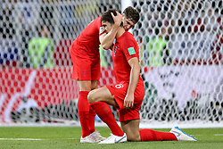 England's John Stones (left) and Harry Maguire hug during the FIFA World Cup 2018, round of 16 match at the Spartak Stadium, Moscow.