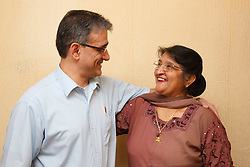 Son with elderly south Asian mother.