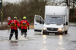 © Licensed to London News Pictures. 28/02/2020. East Cowick UK. The Fire Brigade come to the aid of two men stuck in their vehicle in flood water in East Cowick where residents have ben evacuated from their homes in Yorkshire as the UK prepares for storm Jorge. Photo credit: Andrew McCaren/LNP