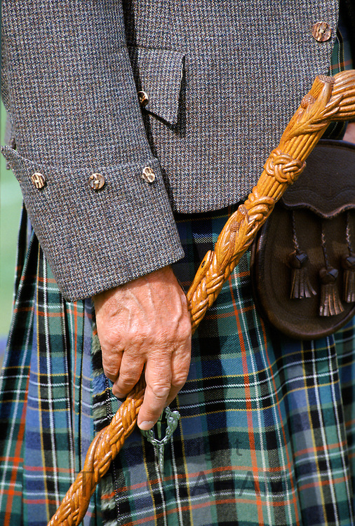 Traditional Scottish kilt and tweed jacket sporran and stick at the Braemar Royal Highland Gathering, the Braemar Games in Scotland