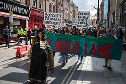London, UK. 12th September, 2021. Local residents and supporters of the Save Brick Lane campaign take part in a funeral procession along Brick Lane organised in protest against the ongoing gentrification of Shoreditch. Campaigners are protesting in particular against plans to develop the Truman Brewery into a shopping centre and 5-storey office building. Tower Hamlets experienced more gentrification than any other London borough between 2010-2016.