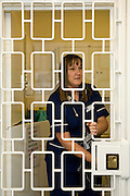 The prison nurse locks the door to the medication room in the prison medical unit. HMP/YOI Askham Grange is a women's open prison serving the Yorkshire area with a capacity of 128 women. It has extensive education, training and mother and Baby facilities.