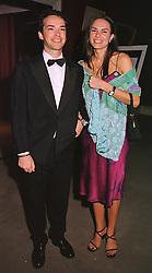 MR & MRS HENRY DENT-BROCKLEHURST leading London social figures, at a dinner in London on 19th May 1999.MSF 77
