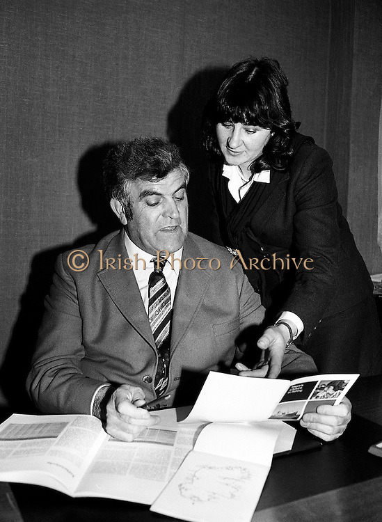 Patrick Power TD, Minister for Fisheries and Forestry, congratulates Kathleen Ní Cheallaigh from Helvick, County Waterford, on receiving her skipper's ticket. Following a Bord Iascaigh Mhara skipper's course, held in her home port, Kathleen is qualified to command a fishing vessel up to seventy-five feet in length. Kathleen works with her brother Padraig on the fishing boat Sinead in Helvick.<br /> 3 February 1981