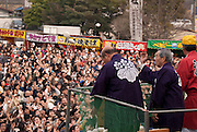Crowds waiting for rice cakes to be thrown to them at the conclusion of the Tagata Fertility Festival at Tagata Shrine.