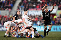 John Cooney of Ulster Rugby box-kicks the ball as Tom Ellis of Bath Rugby looks to charge him down - Mandatory byline: Patrick Khachfe/JMP - 07966 386802 - 18/01/2020 - RUGBY UNION - Kingspan Stadium - Belfast, Northern Ireland - Ulster Rugby v Bath Rugby - Heineken Champions Cup
