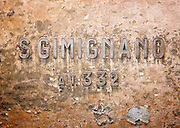 A old sign place marker in the small, hilltop town of San Gimignano, Tuscany, Italy