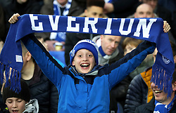 Everton fan show their support during the Emirates FA Cup, third round match at Goodison Park, Liverpool.