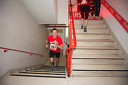 © Licensed to London News Pictures. 03/03/2015.  London.  The Home Show presenter and architect George Clarke joined hundreds of runners today as they climbed 42 floors and 932 steps at Tower 42 as part of Shelters Vertical Rush charity event.      Photo credit : Alison Baskerville/LNP