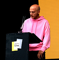 Hassan Akkad letters live at the  Wilderness Festival Cornbury Park Oxfordshire,photo by Mark Anton Smith