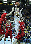 January 26, 2012: Iowa Hawkeyes forward Aaron White (30) puts up a shot over Nebraska Cornhuskers guard Mike Fox (33) as Nebraska Cornhuskers center Jorge Brian Diaz (21) looks on during the NCAA basketball game between the Nebraska Cornhuskers and the Iowa Hawkeyes at Carver-Hawkeye Arena in Iowa City, Iowa on Thursday, January 26, 2012.