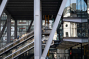 """An office worker descends the escalator at 122 Leadenhall Street, (aka the Leadenhall Building) on Leadenhall Street in the City of London during the Coronavirus pandemic, a time when office workers are still largely still working from home, on 16th September 2020, in London, England. The commercial skyscraper opened in July 2014 and was designed by Rogers Stirk Harbour + Partners and is informally known as """"The Cheesegrater"""" because of its distinctive wedge shape."""