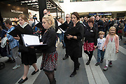 Ex Cathedra choir perform Departure's Hour indise New Street Station during the Birmingham Weekender Arts And Culture Festival on 23rd September 2017 in Birmingham, United Kingdom.