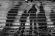 France. Paris. . Shadows of pedestrians in the streets