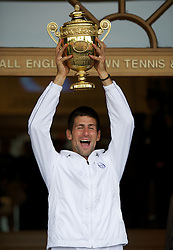 03-07-2011 TENNIS: WIMBLEDON TENNIS CHAMPIONSHIPS: LONDON<br /> Novak Djokovic (SRB) parades the trophy outside the Centre Court clubhouse after winning the Gentlemens Singles Final match<br /> *** UK OUT !***<br /> ©2011-FotoHoogendoorn.nl/EXPA/Rawcliffe