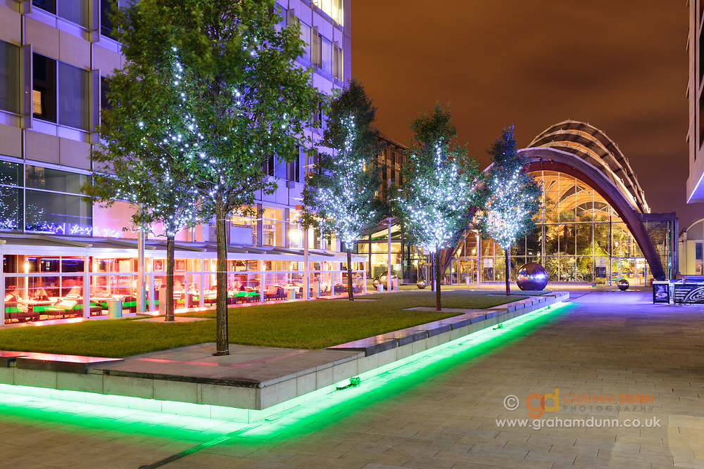 Recently developed, St Paul's Square is fantastically lit at night. Sheffield's famous Winter Garden and steel balls are seen in the background. Urban landscape photography in South Yorkshire, England, UK.