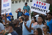 Residents look on during a protest at Craig Ranch North in response to an incident with teens and police officers at a community pool in McKinney, Texas on June 8, 2015.  (Cooper Neill for The New York Times)