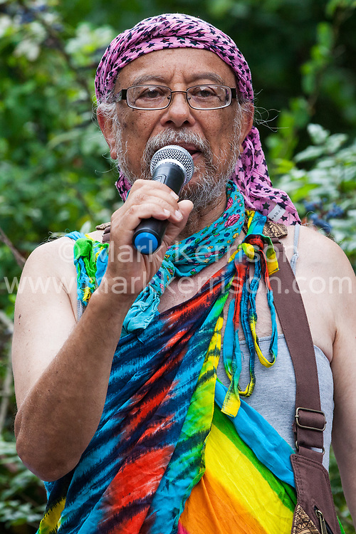 London, UK. 6 July, 2019. A speaker from Radical Faeries addresses activists from Lesbians and Gays Support The Migrants, African Rainbow Family, the Outside Project, Micro Rainbow and other LGBT+ groups preparing to take part in a London Pride Solidarity March in solidarity with those for whom Pride in London is inaccessible and in protest against the corporatisation of Pride in London.