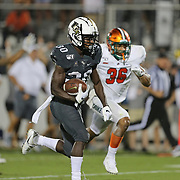ORLANDO, FL - AUGUST 29: Greg McCrae #30 of the UCF Knights outruns Mack Green #36 of the Florida A&M Rattlers for a touchdown during a NCAA football game on August 29 2019 in Orlando, Florida. (Photo by Alex Menendez/Getty Images) *** Local Caption *** Greg McCrae; Mack Green