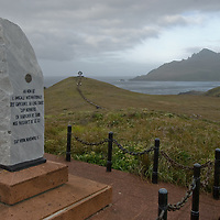 Monument at Cape Horn, Tierra del Fuego, Chile, with Cape Horn Memorial in background.