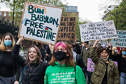 London, UK. 15th May, 2021. Activists hold handmade signs as hundreds of people take part in a Free Palestine SOS Colombia solidarity rally and march from the Colombian embassy to the Israeli Embassy. Speakers highlighted human rights abuses such as forced displacement being directed against Palestinians in Israel and the Occupied Territories and the killing, repression, detention and torture of peaceful demonstrators and human rights defenders in Colombia.