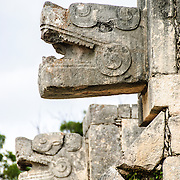 Carved jaguar heads adorning the buildings at Chichen Itza, Mexico.
