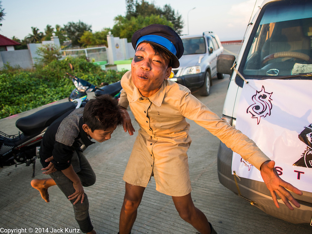 """09 NOVEMBER 2014 - SITTWE, RAKHINE, MYANMAR: Burmese teenagers have a street party at the """"viewpoint,"""" the southern most point in Sittwe. The viewpoint overlooks the Bay of Bengal. Sittwe is a small town in the Myanmar state of Rakhine, on the Bay of Bengal.  PHOTO BY JACK KURTZ"""