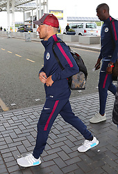 David Silva as the Manchester City team arrive at Manchester Airport as they jet for Iceland