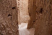 Inside a slot canyon at the Moon Caves in Cathedral Gorge State Park, Panaca, Nevada, USA. Million-year-old lake sediments have eroded into fantastic mud castles at Cathedral Gorge State Park.