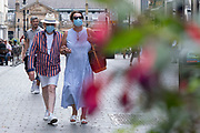 As Britain enters a period of deep recession, with some shops closing either temporarily or permanently as the economic downturn caused by the Covid-19 pandemic cuts hard, people wearing face masks continue to come to the West End to Covent Garden on 13th August 2020 in London, United Kingdom. The Office for National Statistics / ONS has announced that gross domestic product / GDP, the widest gauge of economic health, fell by 20.4% in the second quarter of the year, compared with the previous quarter. This is the biggest decline since records began. The result is that Britain has officially entered recession, as the UK economy shrank more than any other major economy during the coronavirus outbreak.