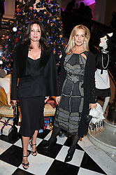 Left to right, TRISH SIMONON and EMMA WOOLLARD at the unveiling of the Claridge's Christmas tree 2011 designed by Alber Elbaz for Lanvin held at Claridge's, Brook Street, London on 5th December 2011.