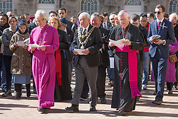 © Licensed to London News Pictures. 25/3/2016. Birmingham, UK. Good Friday Walk of Witness. Churches in Birmingham come together to walk through Birmingham City Centre, visiting Cathedrals and Churches.<br /> Pictured, Bishop David Urquhart and Archbishop Bernard Longley (right) are joined by Lord Mayor Ray Hassall in Victoria Square. Photo credit : Dave Warren/LNP