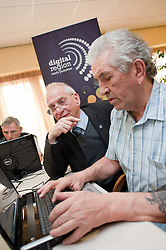 Digital Region Co-Running a series of workshops to equip the elderly with basic computer skills at Bakersfield Court sheltered housing on Longfellow Drive Rotherham- Ron Roberts is helped by Reg Margetts (left)..21 March 2011.Images © Paul David Drabble