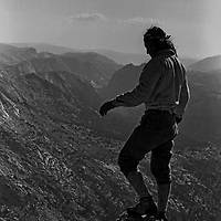 Roger Schley stands atop Blacksmith Peak on the northern boundary of Yosemite National Park in the Sierra Nevada of California.  circa 1974