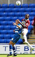 Photo: Daniel Hambury.<br /> Reading v Burnley. Coca Cola Championship.<br /> 29/08/2005.<br /> Reading's Ivar Ingimarsson and Burnley's Gifton Noel-Williams battle for the ball.