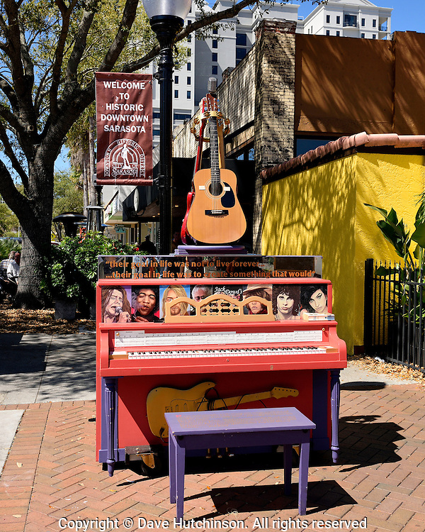 Public art project in downtown Sarasota Florida, 2014, involving placing pianos at accessible locations.