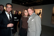 ANDY VALMORBIDA; CARINE ROITFELD;  LAPO ELKANN, Richard Hambleton private view.- New York- Godfather of Street art presented by Vladimir Restoin Roitfeld and Andy Valmorbida in collaboration with Giorgio armani. The Old Dairy. London. 18 November 2010. -DO NOT ARCHIVE-© Copyright Photograph by Dafydd Jones. 248 Clapham Rd. London SW9 0PZ. Tel 0207 820 0771. www.dafjones.com.