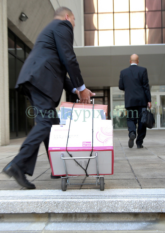31 January 2014. New Orleans, Louisiana. <br /> Boxes of paperwork accompany Ray Nagin, former mayor of New Orleans as he walks to Federal court surrounded by his lawyers on the first full day of his corruption trial at the Federal Courthouse. Nagin is charged with 21counts of corruption including  bribery, conspiracy, money laundering and wire fraud. <br /> Photo; Charlie Varley