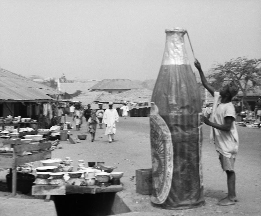 Man with Oversized Beer Bottle, Ibadan, Nigeria, Africa, 1937