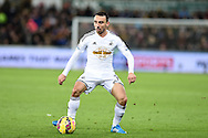 Leon Britton of Swansea city in action.Barclays Premier league match, Swansea city v Queens Park Rangers at the Liberty stadium in Swansea, South Wales on Tuesday 2nd December 2014<br /> pic by Andrew Orchard, Andrew Orchard sports photography.