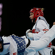 Helena Fromm, Germany, (red) on her way to victory over Hoang Dieu Linh Chu, Vietnam, (blue) during the Taekwondo Women 67kg preliminary round during the London 2012 Olympic games. London, UK. 9th August 2012. Photo Tim Clayton