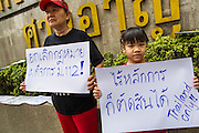 25 JANUARY 2013 - BANGKOK, THAILAND:  Free speech advocates in front of the Criminal Court building. About 70 people protested on behalf of freedom of speech and expression at the Criminal Court building in Bangkok Friday. The protest was called as a result of the 10 year sentence handed down against magazine editor Somyot Prueksakasemsuk on Lese Majeste charges earlier in the week. The protesters burned several legal documents to demonstrate they said was their loss of free speech during the protest.    PHOTO BY JACK KURTZ