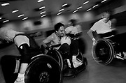 """Disabled athletes play quad rugby, or what is known as """"murder ball"""", in a high school gym in Union, New Jersey, Friday, April 12, 2002."""
