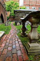 The sagging gravestone of William Matthews in Westminster Hall and Burying Ground near Edgar Allen Poe's grave and memorial in Baltimore, MD.