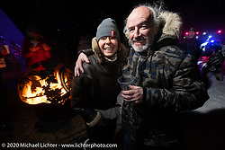 Bene Zaccherini of Italy and French custom bike builder Bertrand Dubet during the wrap party after the Baikal Mile Ice Speed Festival. Maksimiha, Siberia, Russia. Saturday, February 29, 2020. Photography ©2020 Michael Lichter.
