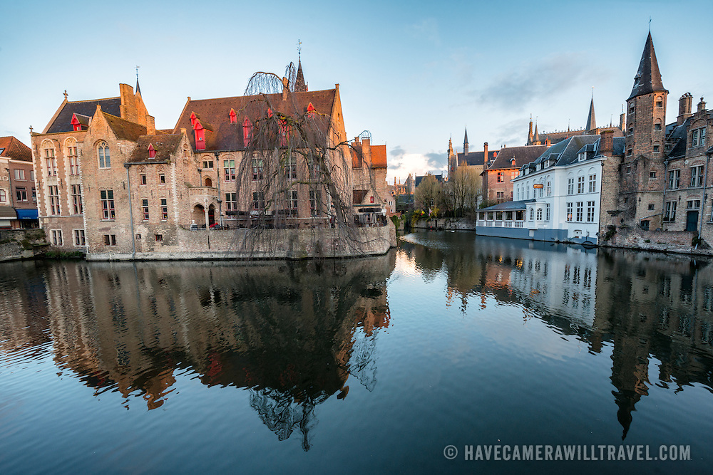 """Sometimes called """"The Venice of the North,"""" the historic Flemish city of Bruges has canals running through the old town. Before the water access became silted up, Bruges was a major commercial port. The building at left of frame is the 15th century mayor's house, """"Perez de Malvenda""""."""