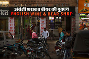 A misspelt English wine and beer shop sign on 21st February 2018 in Jodhpur, Rajasthan, India. Indians have this habit of applying the phonetics directly to the spellings, hence frequent mistakes.