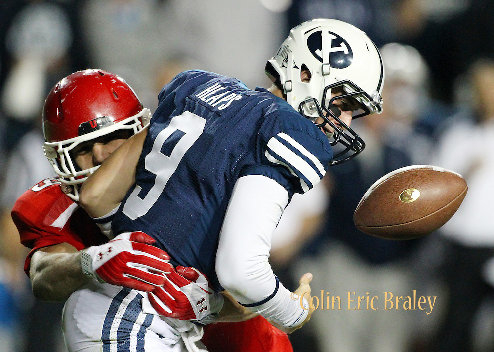 BYU quarterback Jake Heaps (9) fumbles the football as he is hit by Utah linebacker Trevor Reilly (49)during the second half of an NCAA college football game, Saturday, Sept. 17, 2011, at LaVell Edwards Stadium in Provo, Utah. (AP Photo/Colin E Braley)..